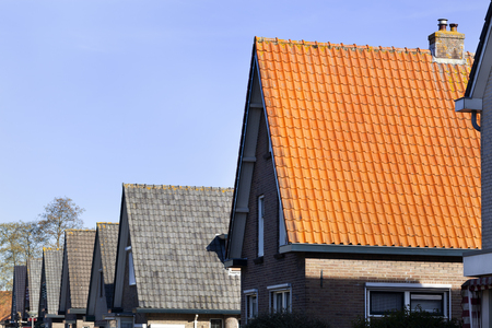 Red and grey tiled roofs in a row in the Netherlands 스톡 콘텐츠