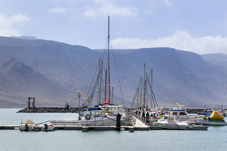 Harbor of Caleta de Sebo on the island La Graciosa of Lanzarote 스톡 콘텐츠