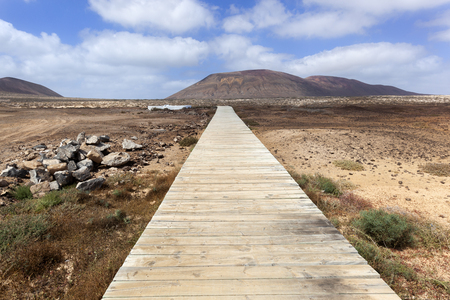 Jetty in volcanic landscape on the island La Graciosa of Lanzarote 스톡 콘텐츠