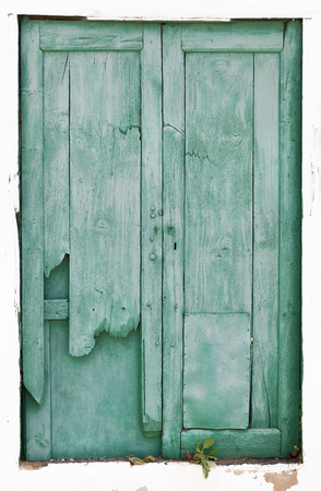 Old green broken wooden door on Lanzarote in Spain 스톡 콘텐츠