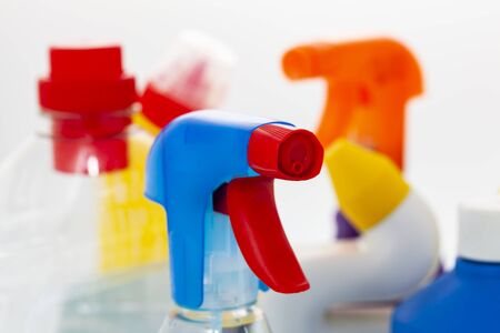 Closeup of chemical cleaner agents in colorful plastic bottles