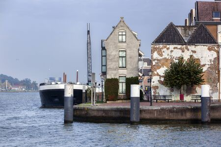 Barge moored at the quay of the river Oude Maas in Dordrecht in the Netherlands
