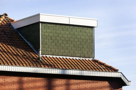 Dormer without a window on a red tiled roof in the Netherlands