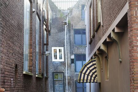 Old small vintage street with side entry with awning in Dordrecht in the Netherlands