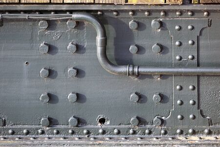 Old steel bridge construction closeup with rivets and bolts in the Netherlands