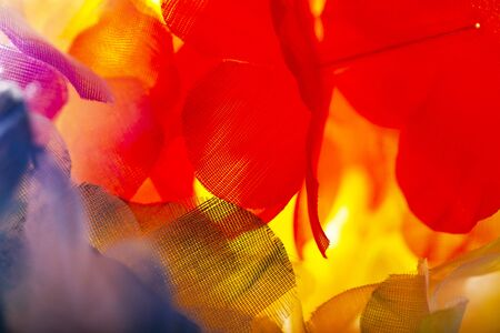Abstract background of a colorful macro of artificial flowers Stockfoto