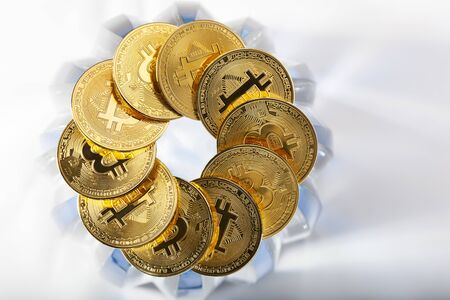 Circle or round chain of golden bitcoins on a blue crystal background