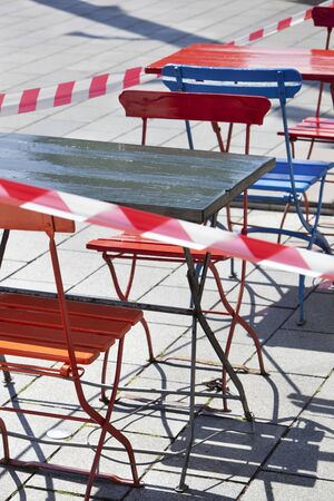 Barrier tape around the empty terraces in Rotterdam during lockdown because of the coronavirus pandemic Imagens
