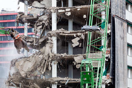 Demolition of a building with an excavator in Rotterdam in the Netherlands Stockfoto