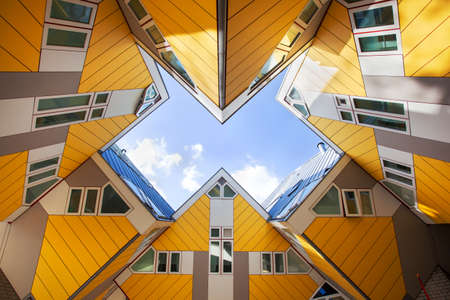 Rotterdam, Netherlands - November 4, 2020: Yellow cubic houses or cube houses by architect Piet Blom on the Blaak in Rotterdam