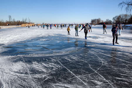 Zevenhuizen, Netherlands - February 13, 2021: Dangerous Ice hole with floes near skaters on Rottemeren Editorial