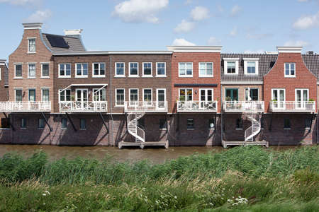 New built houses near water in a traditional architecture style in Gouda in the Netherlands