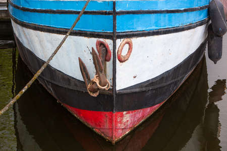 Bow of an old steel ship moored in harbor in the Netherlands Stock Photo