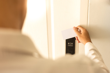 contactless: Man using keycard contactless for unlock door in hotel. Stock Photo
