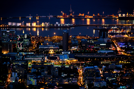 Downtown city lights illuminating the Port of Cape Town just after dusk