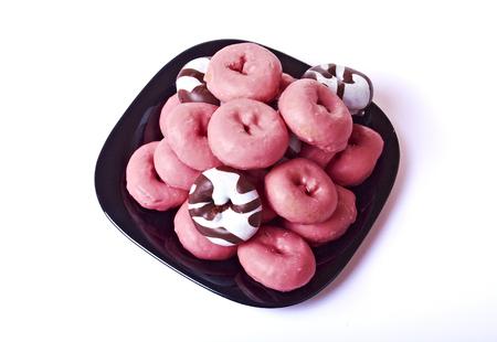 rosa negra: Apilar pasteles poco saludable rosa, blanco y negro