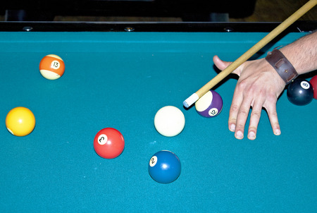 game of pool: Young man playing a game of pool Stock Photo