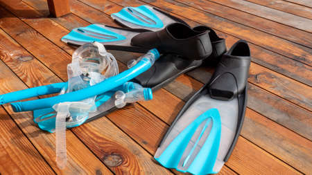 Snorkeling equipment on wooden floor