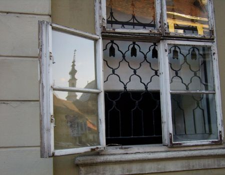 iron curtain: reflection of a church in an old window, Budapest Stock Photo