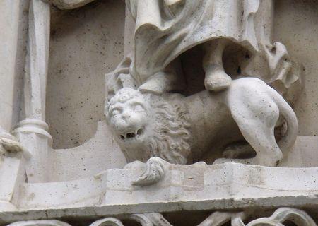 smiling stone-lion at Buda Castle, Budapest photo