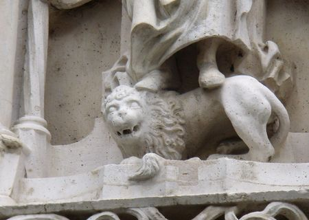 smiling stone-lion at Buda Castle, Budapest photo