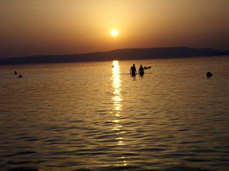 bathers: silhouette of summer bathers, Balaton Lake Stock Photo