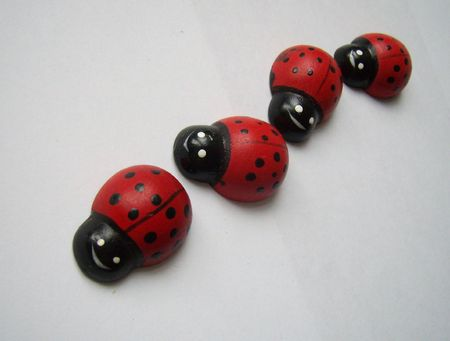 twisting: wooden ladybirds in twisting line Stock Photo