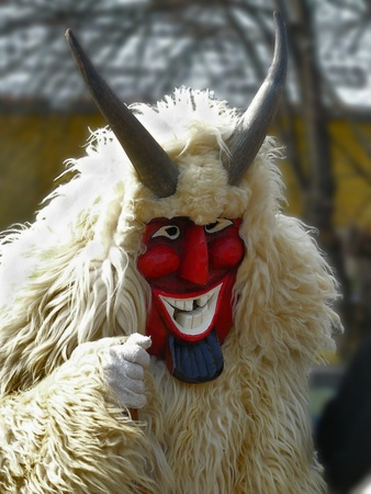 Smiling masked man on funeral of winter, Mohacs town, Hungary
