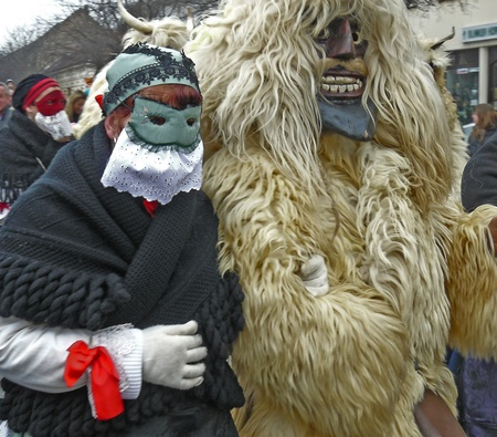 Traditional couple in Mohacs town funeral of winter, Hungary photo