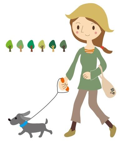 女性は犬と散歩します。