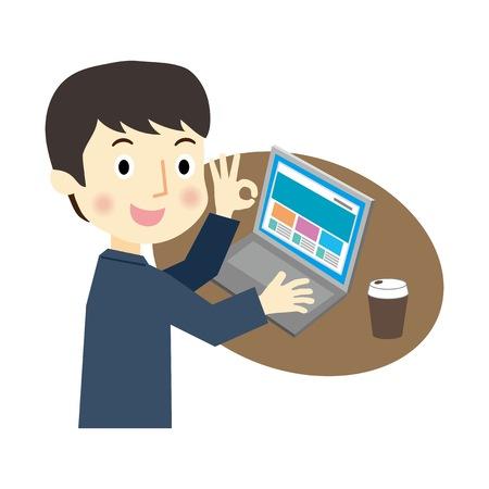 A businessman operating a laptop PC