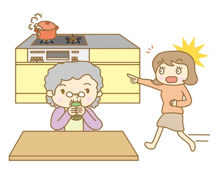 Senior woman forgetting to turn off gas fire