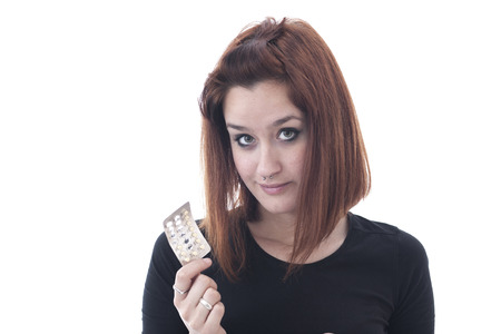 Young woman showing pack of pills photo