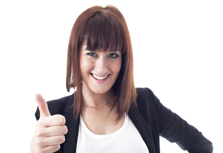 Young businesswoman with thumbs up photo