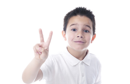 Child showing victory sign photo
