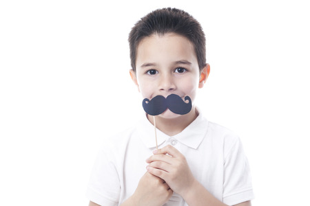 whote: Child with fake moustache. Isolated on whote.