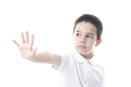 Child showing stop gesture. Isolated on white. photo