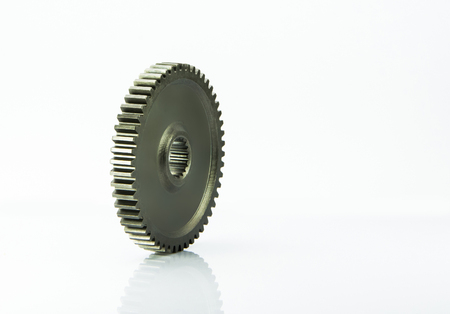 metal gears: Metal gears of the mechanism disassembled broken on a gray background Stock Photo