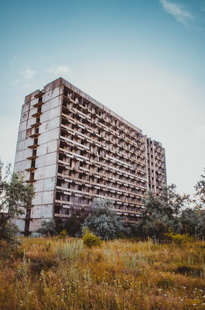 highrises: abandoned building old hotel high-rises in the thickets of weeds and trees