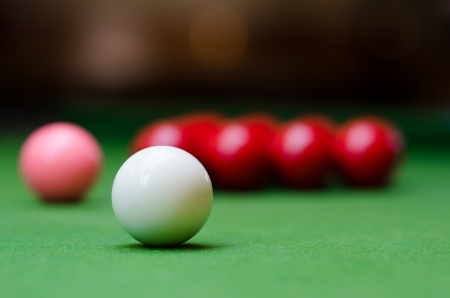 snooker balls: White, red, and pink snooker balls on the table Stock Photo