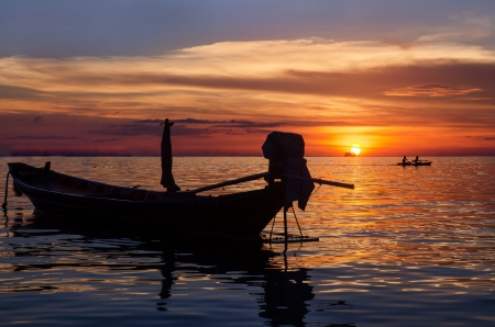 long-tailed boat and sunset photo
