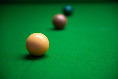 snooker balls: Snooker balls on the green table Stock Photo