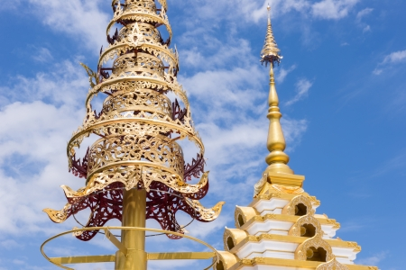 tiered: Golden tiered umbrella with blue sky