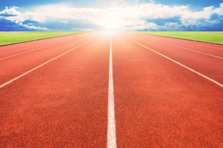 olympiad: Running track over blue sky and clouds Stock Photo
