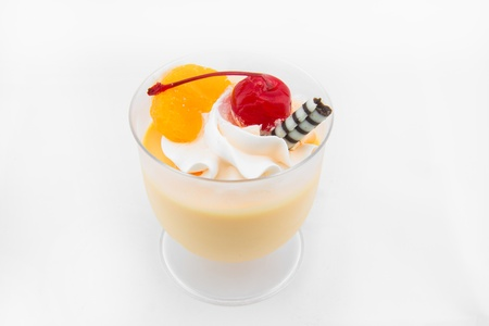 cheery: Orange Mousse with red cheery in glass