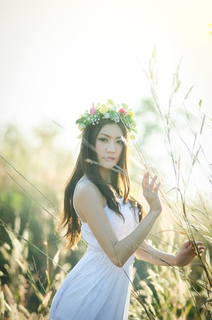 Pretty girl in a spring  flower garden photo