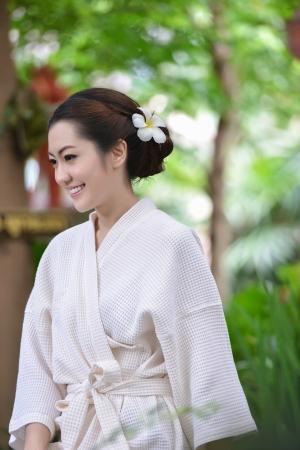 the enchantress: Beautiful girl in garden Stock Photo