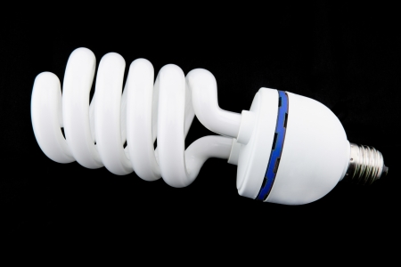 bul: white energy saving bul or Illuminated light bulb on black background
