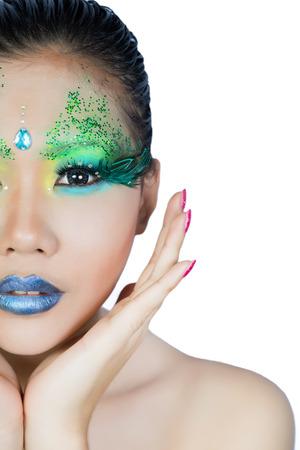 eyeshades: beautiful women with perfect art make up and long false eyelashes made from feathers
