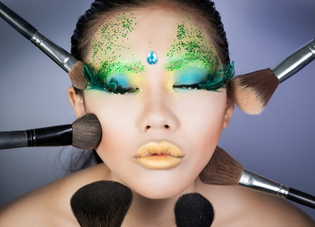 beautiful women with perfect art make up and long false eyelashes made from feathers photo